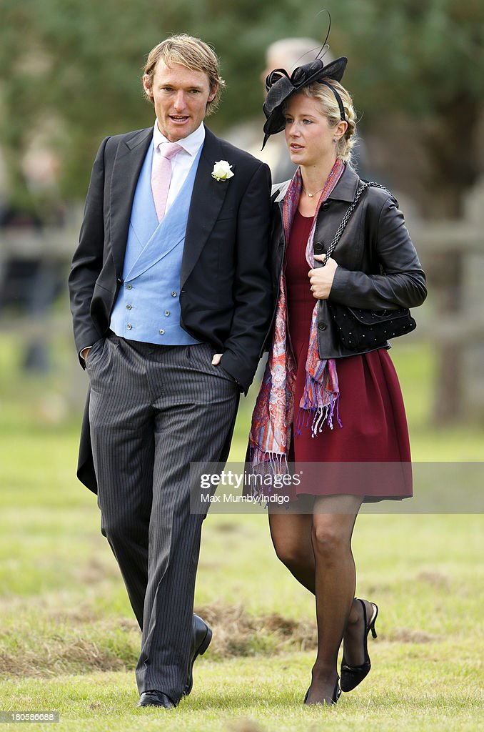 Mark Tomlinson and Laura Bechtolsheimer attend the wedding of James Meade and Lady Laura Marsham at the Parish Church of St Nicholas in Gayton on...