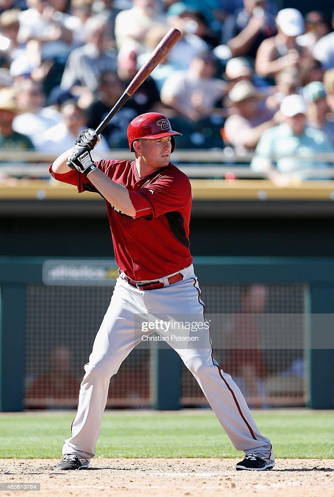 Mark Trumbo of the Arizona Diamondbacks bats against the Oakland Athletics during the spring training game at HoHoKam Stadium on March 10 2015 in...