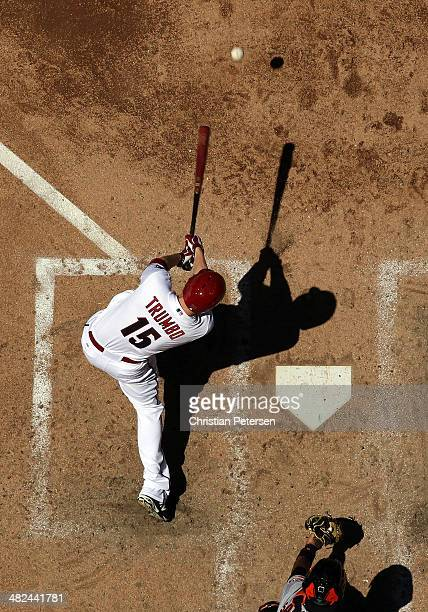 Mark Trumbo of the Arizona Diamondbacks hits a ground ball out during the MLB game against the San Francisco Giants at Chase Field on April 3 2014 in...