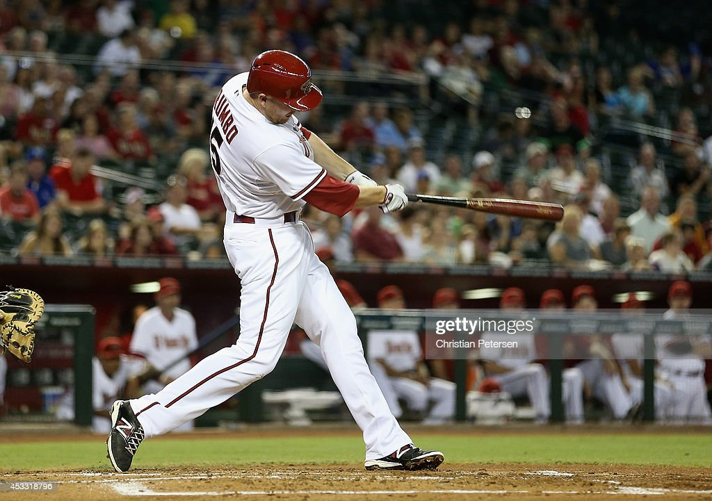 Mark Trumbo #15 of the Arizona Diamondbacks hits a RBI on a sacrifice fly during the first inning of the MLB game against the Kansas City Royals at Chase Field on August 7, 2014 in Phoenix, Arizona.