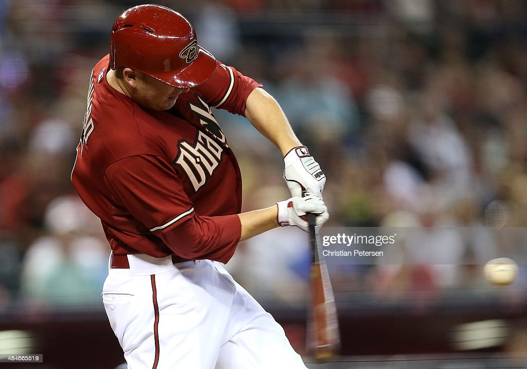 <a gi-track='captionPersonalityLinkClicked' href=/galleries/search?phrase=Mark+Trumbo&family=editorial&specificpeople=4921667 ng-click='$event.stopPropagation()'>Mark Trumbo</a> #15 of the Arizona Diamondbacks hits a three run home-run against the Los Angeles Dodgers during the seventh inning of the MLB game at Chase Field on April 13, 2014 in Phoenix, Arizona. The Dodgers defeated the Diamondbacks 8-6.