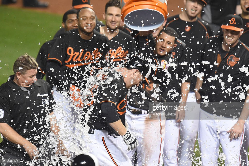 Mark Trumbo #45 of the Baltimore Orioles celebrates a walk off home run in the 12th inning during a baseball game against the against the Arizona Diamondbacks at Oriole Park at Camden Yards on September 23, 2016 in Baltimore, Maryland. The Orioles won 3-2 in 12 innings.