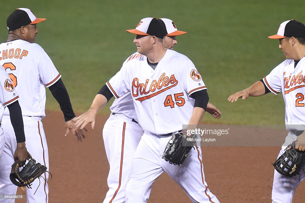 Mark Trumbo #45 of the Baltimore Orioles celebrates a win with teammates after a baseball game against the the Washington Nationals at Oriole Park at Camden Yards on August 22, 2016 in Baltimore, Maryland. The Oriole won 4-3.