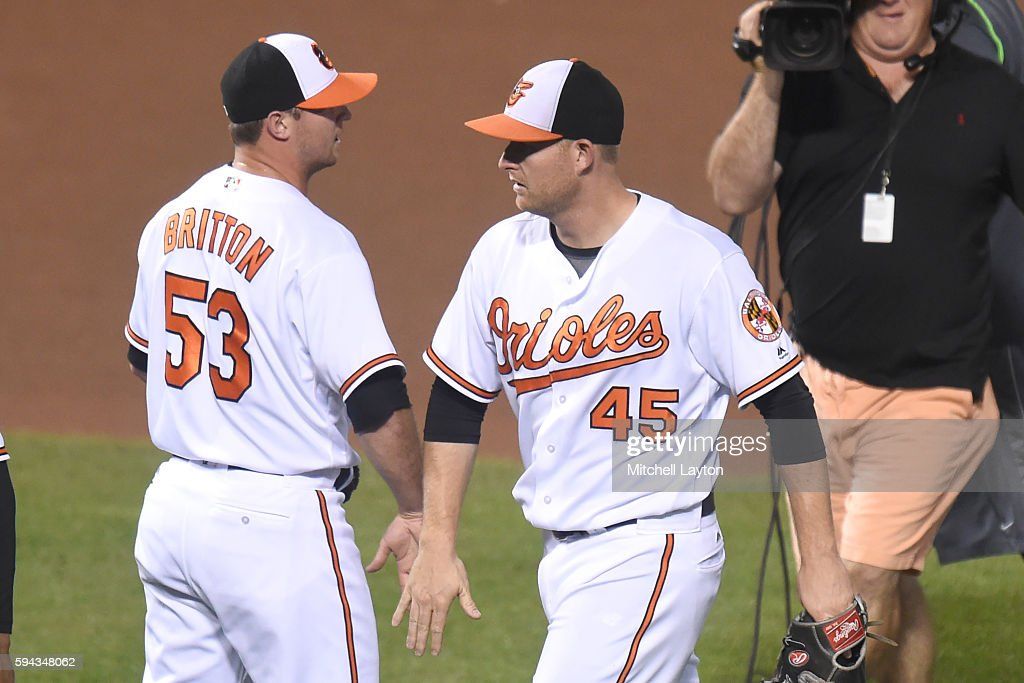 Mark Trumbo #45 of the Baltimore Orioles celebrates a win with Zach Britton #53 after a baseball game against the the Washington Nationals at Oriole Park at Camden Yards on August 22, 2016 in Baltimore, Maryland. The Oriole won 4-3.