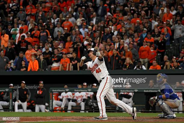 Mark Trumbo of the Baltimore Orioles follows through after hitting a walkoff home run against the Toronto Blue Jays during the eleventh inning in...