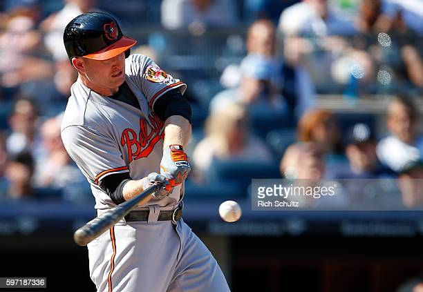 Mark Trumbo of the Baltimore Orioles hits a home run during the eighth inning of a game against the New York Yankees at Yankee Stadium on August 28...