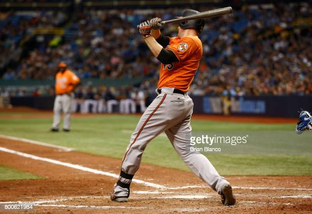 Mark Trumbo of the Baltimore Orioles hits a tworun double off of pitcher Jumbo Diaz of the Tampa Bay Rays during the seventh inning of a game on June...