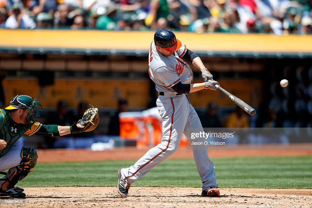 Mark Trumbo #45 of the Baltimore Orioles hits an RBI single against the Oakland Athletics during the fourth inning at the Oakland Coliseum on August 11, 2016 in Oakland, California. The Baltimore Orioles defeated the Oakland Athletics 9-6.