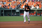 Mark Trumbo of the Baltimore Orioles rounds the bases after hitting a three run home run against the Cleveland Indians in the first inning at Oriole...