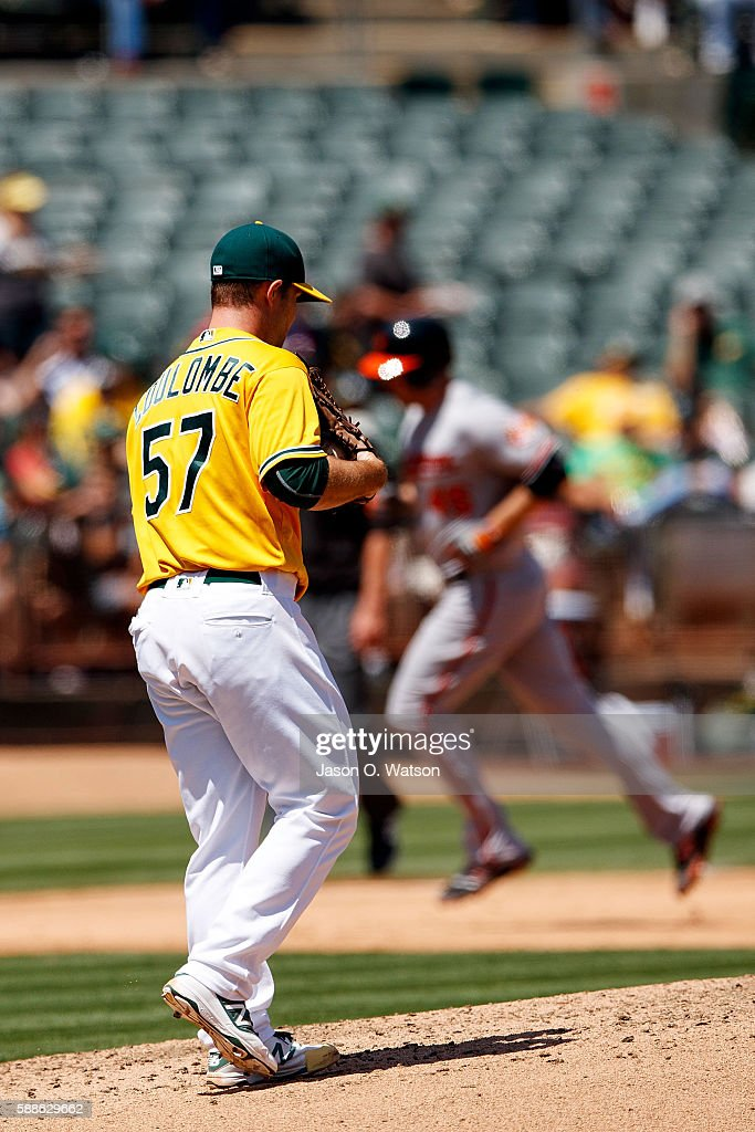Mark Trumbo #45 of the Baltimore Orioles rounds the bases after hitting a grand slam home run off of Daniel Coulombe #57 of the Oakland Athletics during the fifth inning at the Oakland Coliseum on August 11, 2016 in Oakland, California. The Baltimore Orioles defeated the Oakland Athletics 9-6.