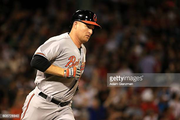 Mark Trumbo of the Baltimore Orioles rounds the bases after hitting a solo home run in the second inning of a game against the Boston Red Sox at...