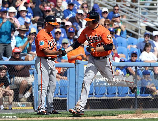Mark Trumbo of the Baltimore Orioles rounds third after hitting a home run in the fourth inning during the game against the Toronto Blue Jays at...