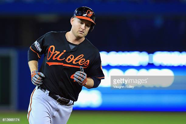Mark Trumbo of the Baltimore Orioles runs the bases after hitting a tworun home run in the fourth inning against the Toronto Blue Jays during the...