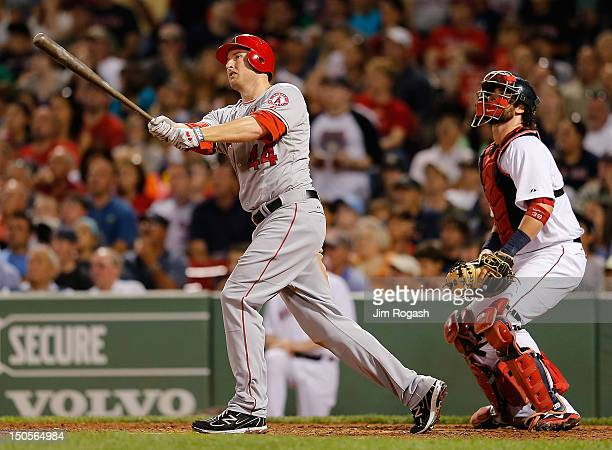 Mark Trumbo of the Los Angeles Angels hits a two run home run off of Aaron Cook of the Boston Red Sox in the fifth inning at Fenway Park on August 21...