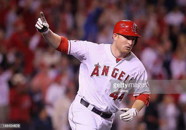 Mark Trumbo of the Los Angeles Angels of Anaheim celebrates as he rounds first base after hitting a walk off home run in the ninth inning against the...