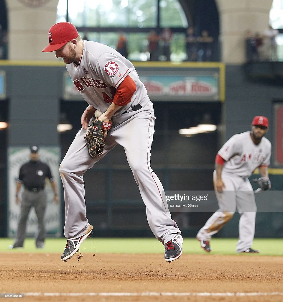 <a gi-track='captionPersonalityLinkClicked' href=/galleries/search?phrase=Mark+Trumbo&family=editorial&specificpeople=4921667 ng-click='$event.stopPropagation()'>Mark Trumbo</a> #44 of the Los Angeles Angels of Anaheim fields a hard grounder hit by Marc Krauss #59 of the Houston Astros in the seventh inning on September 15, 2013 at Minute Maid Park in Houston, Texas.