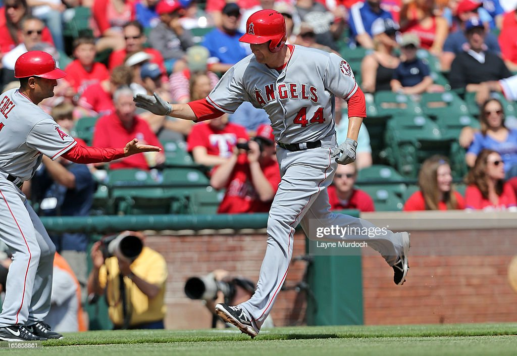 <a gi-track='captionPersonalityLinkClicked' href=/galleries/search?phrase=Mark+Trumbo&family=editorial&specificpeople=4921667 ng-click='$event.stopPropagation()'>Mark Trumbo</a> #44 of the Los Angeles Angels of Anaheim gets a hand shake from 3rd base coach Dino Ebel after hitting a two-run homer against Matt Harrison #54 of the Texas Rangers in the bottom of the 1st inning on April 6, 2013 at the Rangers Ballpark in Arlington in Arlington, Texas.