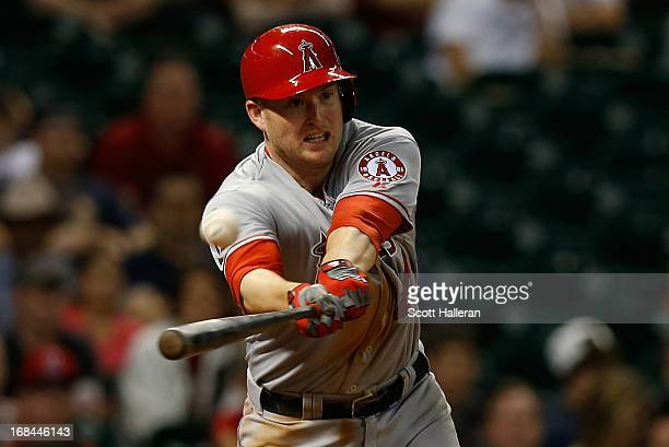 Mark Trumbo of the Los Angeles Angels of Anaheim hits a tworun double to right field during the eighth inning against the Houston Astros at Minute...