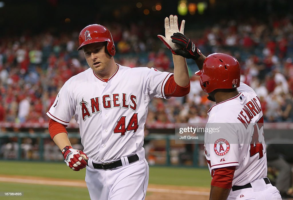 Mark Trumbo #44 of the Los Angeles Angels of Anaheim is congratulated by Howie Kendrick #47 after hitting a solo home run in the second inning against the Baltimore Orioles at Angel Stadium of Anaheim on May 3, 2013 in Anaheim, California.