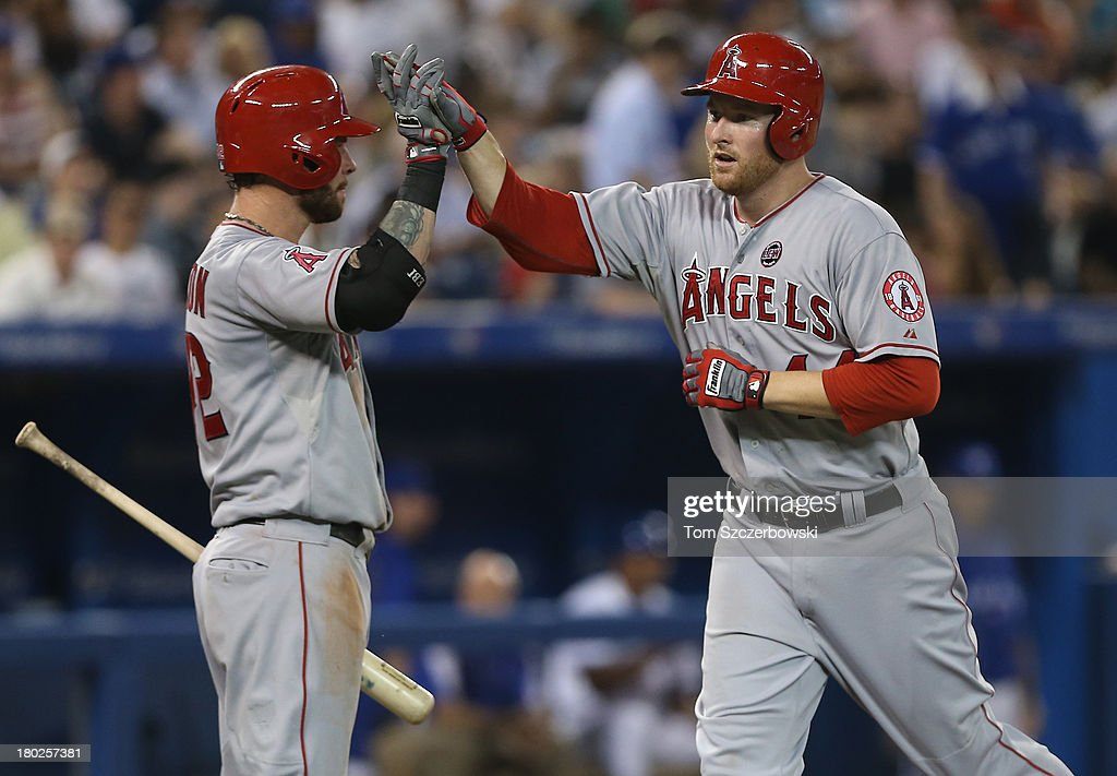 <a gi-track='captionPersonalityLinkClicked' href=/galleries/search?phrase=Mark+Trumbo&family=editorial&specificpeople=4921667 ng-click='$event.stopPropagation()'>Mark Trumbo</a> #44 of the Los Angeles Angels of Anaheim is congratulated by Josh Hamilton #32 after hitting a solo home run in the fifth inning during MLB game action against the Toronto Blue Jays on September 10, 2013 at Rogers Centre in Toronto, Ontario, Canada.