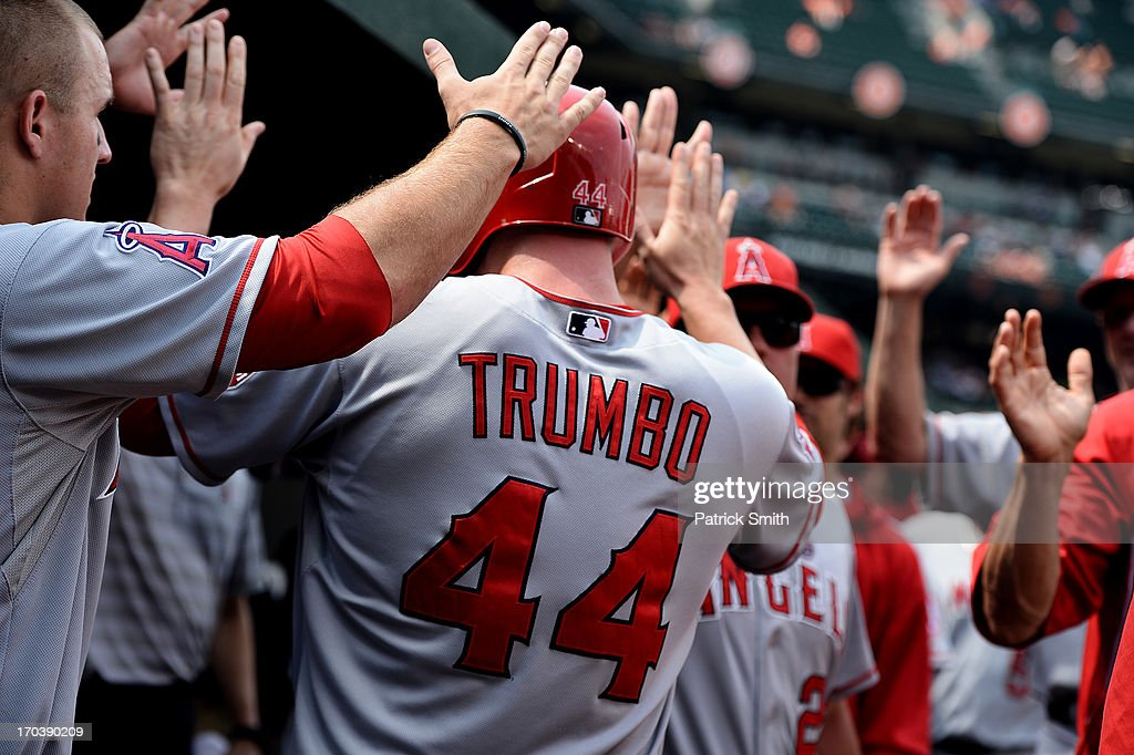 <a gi-track='captionPersonalityLinkClicked' href=/galleries/search?phrase=Mark+Trumbo&family=editorial&specificpeople=4921667 ng-click='$event.stopPropagation()'>Mark Trumbo</a> #44 of the Los Angeles Angels of Anaheim is congratulated in the dugout after scoring off a hit by Josh Hamilton #32 of the Los Angeles Angels of Anaheim (not pictured) in the ninth inning against the Baltimore Orioles at Oriole Park at Camden Yards on June 12, 2013 in Baltimore, Maryland. The Los Angeles Angels of Anaheim won, 9-5.