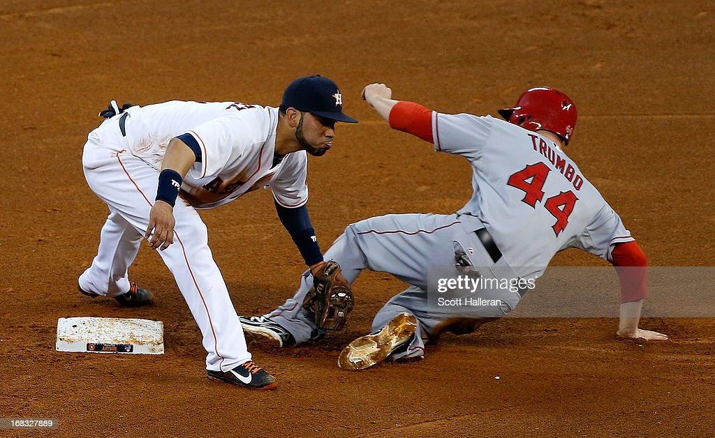 Mark Trumbo #44 of the Los Angeles Angels of Anaheim is tagged out at second base by Marwin Gonzalez #9 of the Houston Astros in the fourth inning at Minute Maid Park on May 8, 2013 in Houston, Texas.