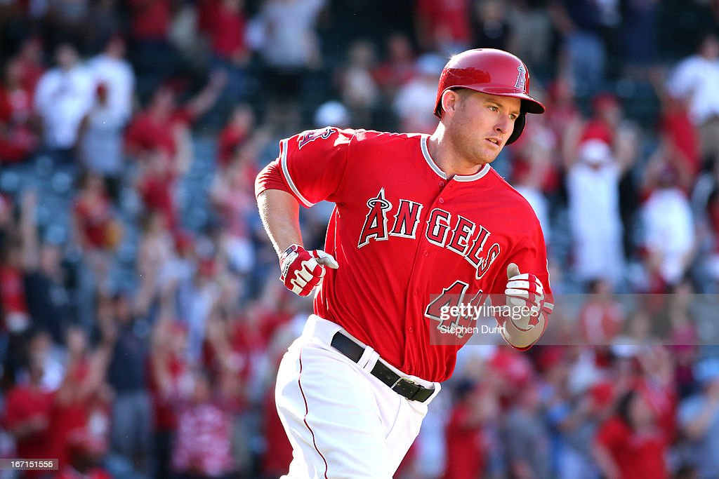 <a gi-track='captionPersonalityLinkClicked' href=/galleries/search?phrase=Mark+Trumbo&family=editorial&specificpeople=4921667 ng-click='$event.stopPropagation()'>Mark Trumbo</a> #44 of the Los Angeles Angels of Anaheim rounds first base after hitting a game winning walk off home run in the 13th inning against the Detroit Tigers at Angel Stadium of Anaheim on April 21, 2013 in Anaheim, California. The Angels won 4-3 in 13 innings.