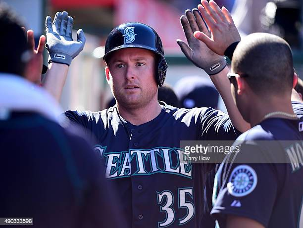 Mark Trumbo of the Seattle Mariners celebrates his solo homerun to tie the game 22 with the Los Angeles Angels during the eighth inning at Angel...