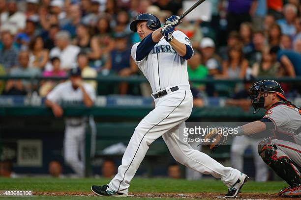Mark Trumbo of the Seattle Mariners hits a threerun home run in the first inning against the Baltimore Orioles at Safeco Field on August 11 2015 in...