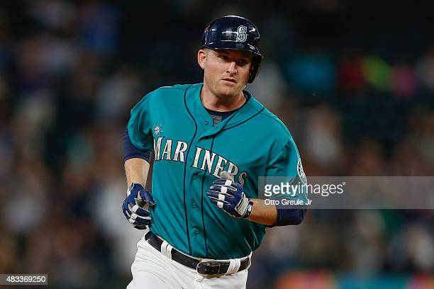Mark Trumbo of the Seattle Mariners rounds the bases after hitting a solo home run against the Texas Rangers in the fifth inning at Safeco Field on...