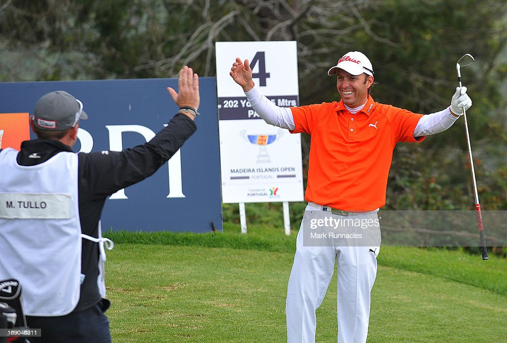 Mark Tullo of Argentina celebrates with his Caddy Barry Corwall after a hole in one at the 4th hole during Day Four of the Madeira Islands Open - Portugal - BPI at Club de Golf do Santo da Serra on May 19, 2013 in Funchal, Madeira, Portugal.
