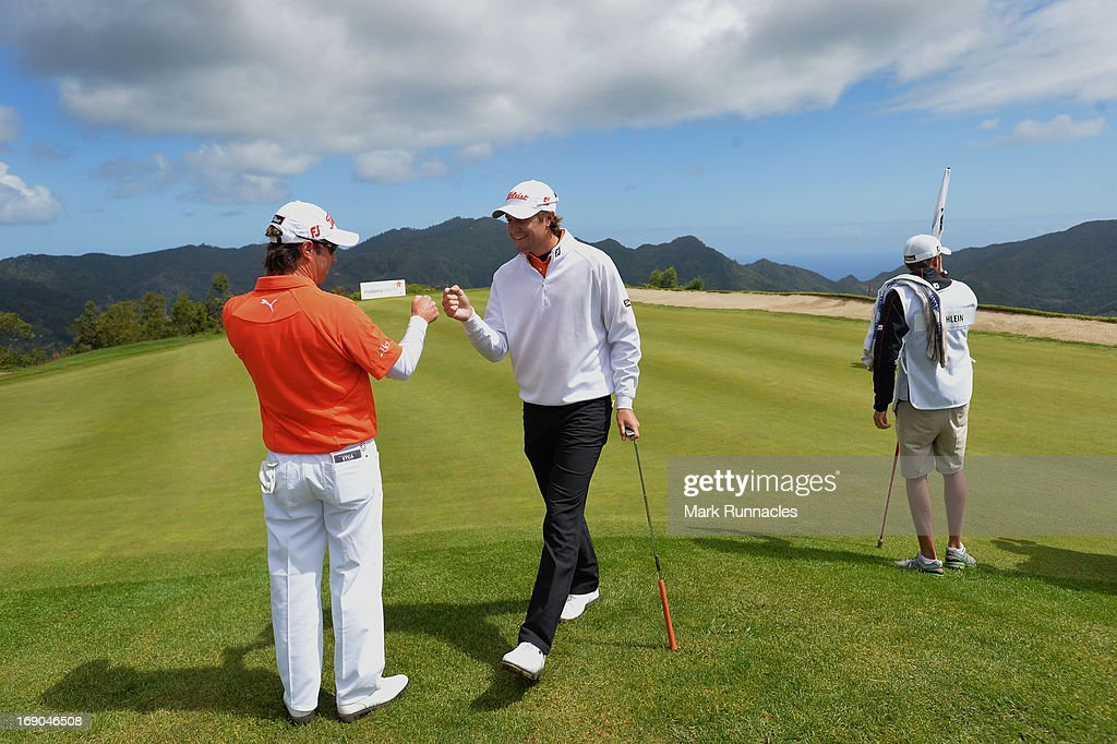 Mark Tullo of Argentina (L) celebrates with Peter Uihlein of the USA after his hole in one at the 4th hole during Day Four of the Madeira Islands Open - Portugal - BPI at Club de Golf do Santo da Serra on May 19, 2013 in Funchal, Madeira, Portugal.