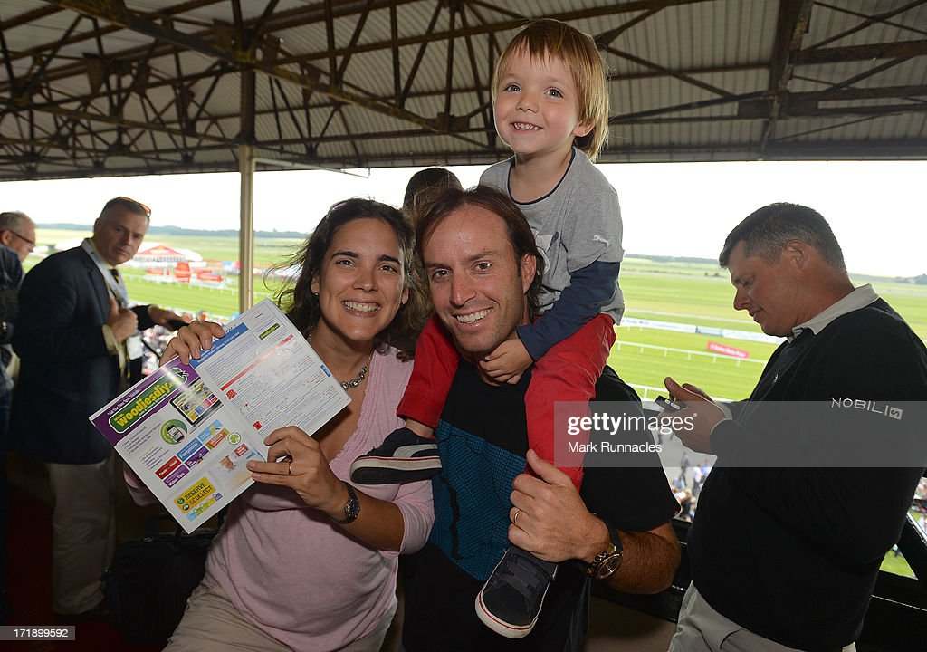 Mark Tullo of Chile with his wife Magdalena Correa and son Danny attend The Dubai Duty Free Irish Derby after finishing the Third Round of the Irish Open at Carton House Golf Club on June 29, 2013 in Maynooth, Ireland.