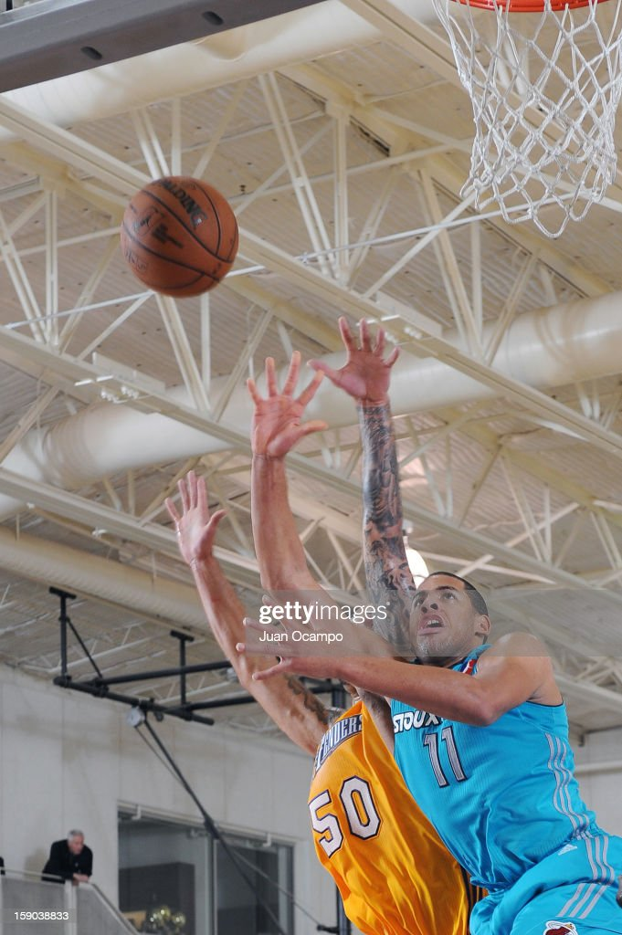 Mark Tyndale #11 of the Sioux Falls Skyforce goes to the basket against <a gi-track='captionPersonalityLinkClicked' href=/galleries/search?phrase=Robert+Sacre&family=editorial&specificpeople=4682421 ng-click='$event.stopPropagation()'>Robert Sacre</a> #50 of the Los Angeles D-Fenders on January 5, 2013 at Toyota Sports Center in El Segundo, California.