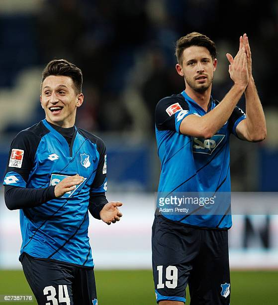 Mark Uth and Baris Atik of TSG 1899 Hoffenheim celebrate victory after the Bundesliga match between TSG 1899 Hoffenheim and 1 FC Koeln at Wirsol...