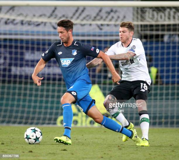 Mark Uth of Hoffenheim and Alberto Moreno of Liverpool battle for the ball during the UEFA Champions League Qualifying PlayOffs Round First Leg match...
