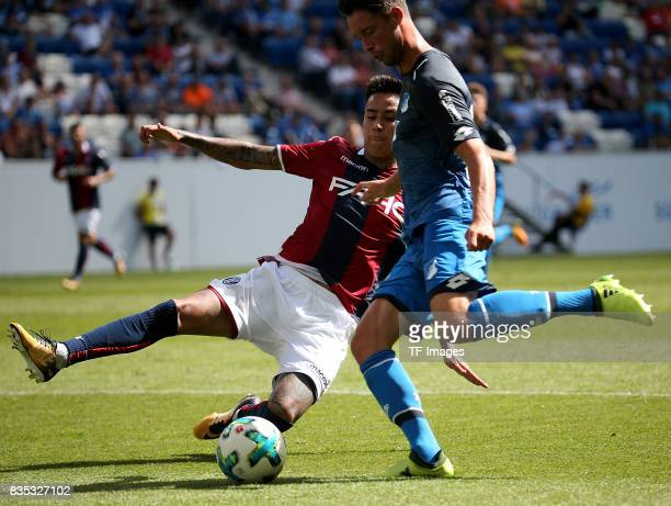 Mark Uth of Hoffenheim and Erick Pulgar of Bologna battle for the ball during the preseason friendly match between TSG 1899 Hoffenheim and FC Bologna...
