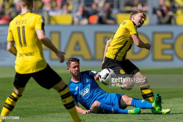 Mark Uth of Hoffenheim and Marcel Schmelzer of Dortmund battle for the ball during the Bundesliga match between Borussia Dortmund and TSG 1899...