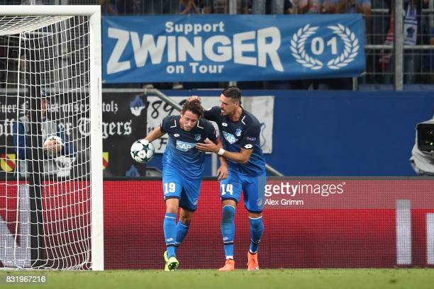 Mark Uth of Hoffenheim celebrates his goal with Sandro Wagner of Hoffenheim during the UEFA Champions League Qualifying PlayOffs Round First Leg...