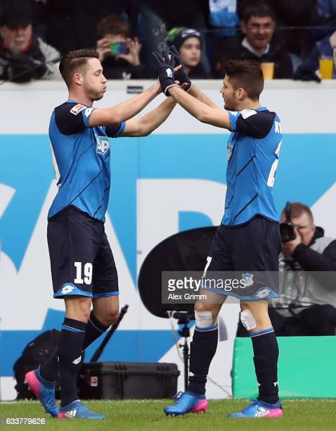 Mark Uth of Hoffenheim celebrates his team's first goal with team mate Andrej Kramaric during the Bundesliga match between TSG 1899 Hoffenheim and 1...