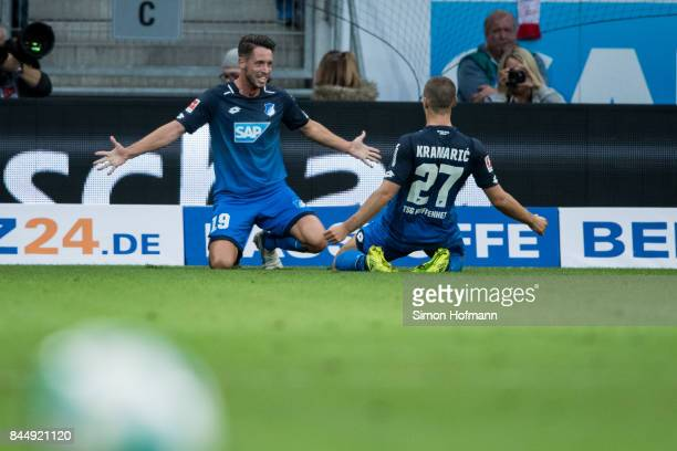 Mark Uth of Hoffenheim celebrates his team's first goal with team mate Andrej Kramaric during the Bundesliga match between TSG 1899 Hoffenheim and FC...