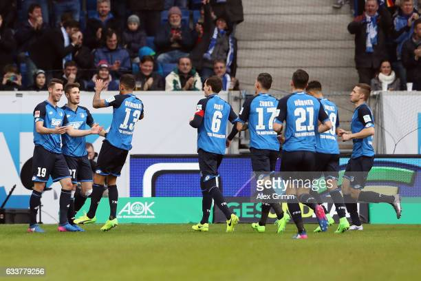 Mark Uth of Hoffenheim celebrates his team's first goal with team mates during the Bundesliga match between TSG 1899 Hoffenheim and 1 FSV Mainz 05 at...