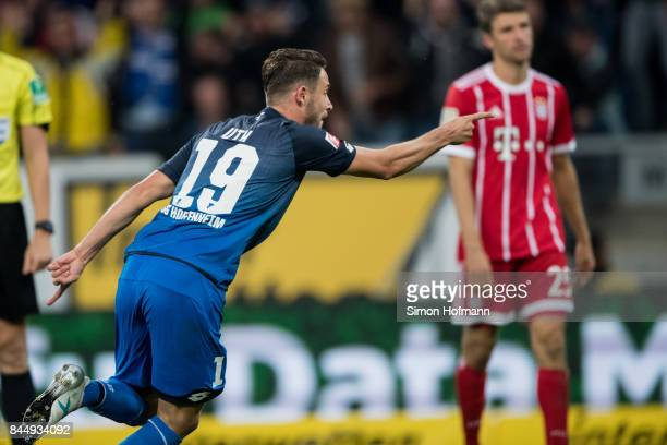Mark Uth of Hoffenheim celebrates his team's second goal during the Bundesliga match between TSG 1899 Hoffenheim and FC Bayern Muenchen at Wirsol...