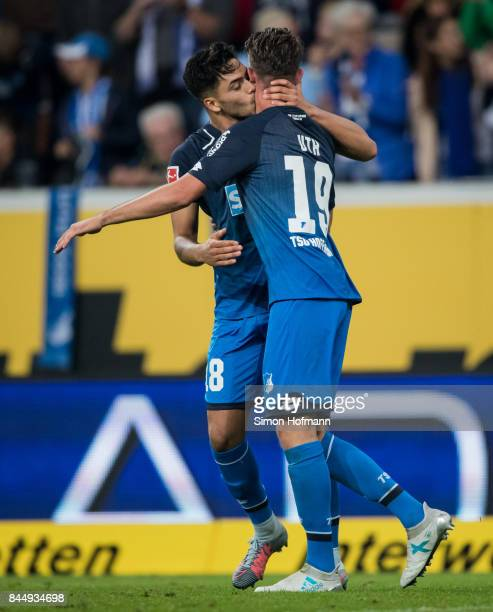 Mark Uth of Hoffenheim celebrates his team's second goal with team mate Nadiem Amiri during the Bundesliga match between TSG 1899 Hoffenheim and FC...