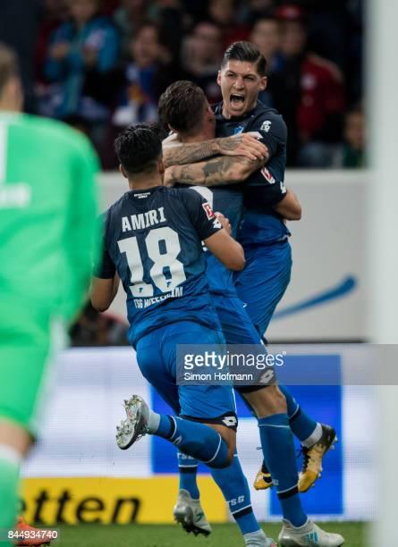 Mark Uth of Hoffenheim celebrates his team's second goal with team mate Steven Zuber during the Bundesliga match between TSG 1899 Hoffenheim and FC...