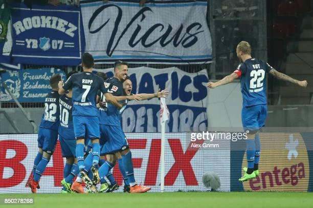 Mark Uth of Hoffenheim celebrates his team's third goal with team mates during the Bundesliga match between 1 FSV Mainz 05 and TSG 1899 Hoffenheim at...