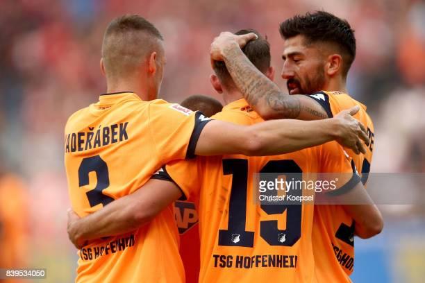 Mark Uth of Hoffenheim celebrates the second goal with Krem Demirbay of Hoffenheim during the Bundesliga match between Bayer 04 Leverkusen and TSG...