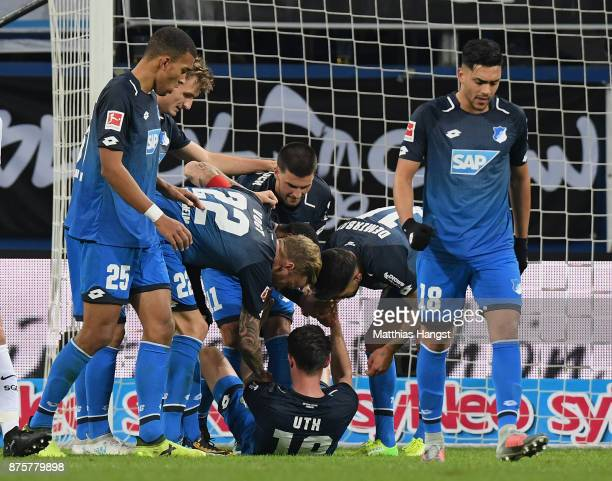 Mark Uth of Hoffenheim celebrates with his teammates after scoring his team's first goal during the Bundesliga match between TSG 1899 Hoffenheim and...