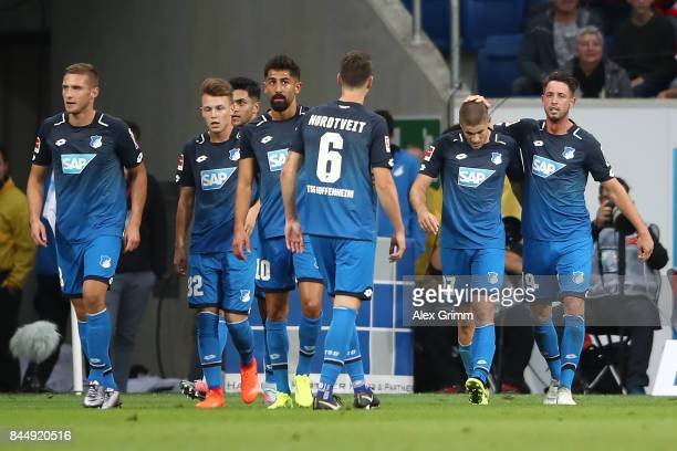 Mark Uth of Hoffenheim celebrates with team mates after he scored the first goal to make it 10 during the Bundesliga match between TSG 1899...