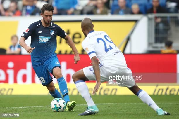 Mark Uth of Hoffenheim fights for the ball with Naldo of Schalke during the Bundesliga match between TSG 1899 Hoffenheim and FC Schalke 04 at Wirsol...